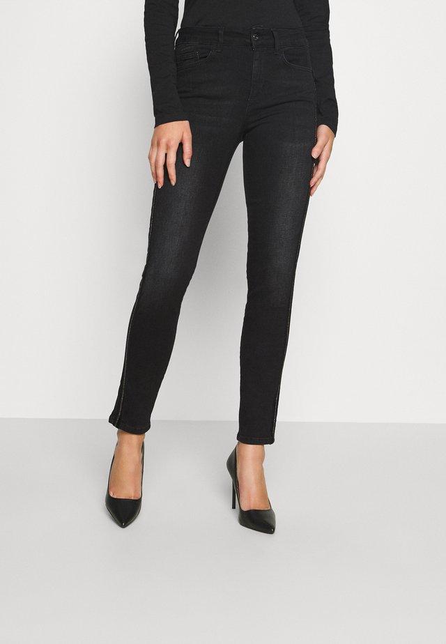 DIVINE - Jeans Skinny - black