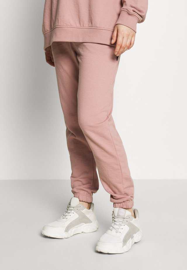 Tracksuit bottoms - rose pink