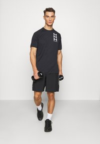 Under Armour - T-shirts print - black - 1