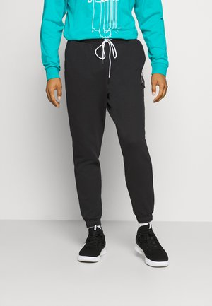 PIVOT - Tracksuit bottoms - black