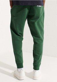 Superdry - CODE - Tracksuit bottoms - dark green - 1