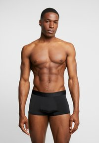 Calvin Klein Underwear - LOW RISE TRUNK - Pants - black - 1