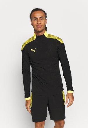 FTBLNXT 1/4 ZIP - Koszulka sportowa - black/ultra yellow