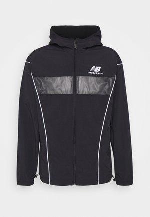ATHLETICS WINDBREAKER - Summer jacket - black