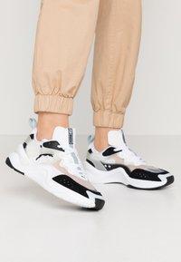 Puma - RISE - Sneakers - black/white - 0
