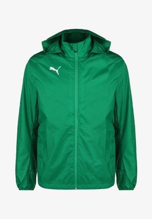 LIGA TRAINING - Waterproof jacket - pepper green / puma white