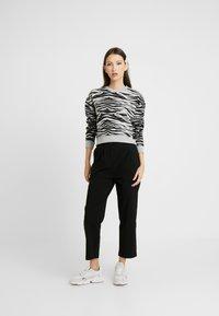 Urban Classics - LADIES HIGH WAIST CROPPED - Trousers - black - 1