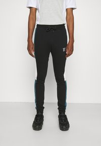 11 DEGREES - CUT AND SEW JOGGERS SKINNY FIT - Teplákové kalhoty - black/indian teal/white - 0