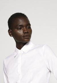 HUGO - THE FITTED - Button-down blouse - white - 4