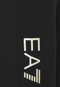 EA7 Emporio Armani - Pantalones deportivos - black/light gold - 5