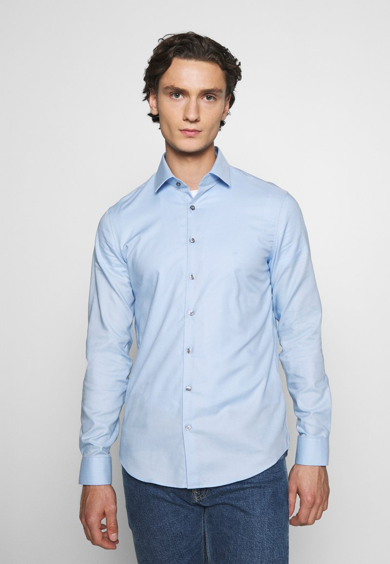 Calvin Klein Tailored - DOBBY EASY CARE SLIM - Formal shirt - blue