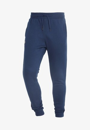 RIVAL  JOGGER - Tracksuit bottoms - academy/black