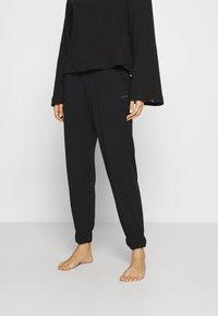 Calvin Klein Underwear - PERFECTLY FIT FLEX JOGGER - Pyjama bottoms - black - 0