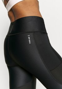 Under Armour - ISO CHILL RUN ANKLE - Leggings - black - 4