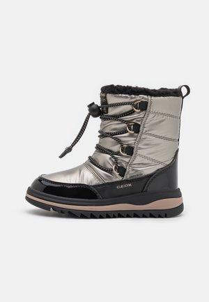ADELHIDE GIRL ABX - Zimní obuv - dark gold/black