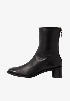 ELLINOR - Kotníkové boty - black