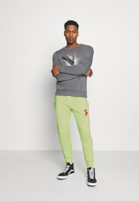 Nike Sportswear - PANT - Tracksuit bottoms - liquid lime - 1