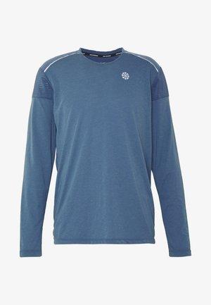 RISE HYBRID - Sports shirt - thunderstorm