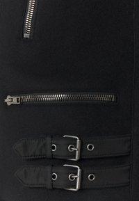 MOSCHINO - LONG JACKET - Faux leather jacket - black - 2