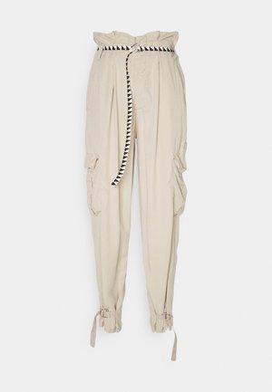 SAFARI PANTS - Trousers - safari