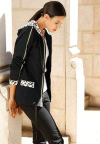 Laura Kent - Zip-up sweatshirt - schwarz - 1