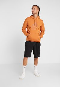 adidas Performance - Zip-up hoodie - brown - 1