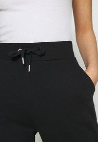 NU-IN - FIT - Tracksuit bottoms - black - 5