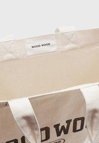 Wood Wood - HIGH UNISEX - Cabas - off-white/black - 2