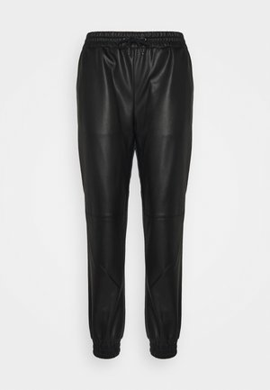 BECKIE - Tracksuit bottoms - black