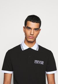 Versace Jeans Couture - PLAIN - Polo shirt - nero - 3