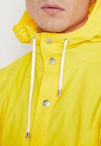 Rains - UNISEX LONG JACKET - Impermeable - yellow - 4