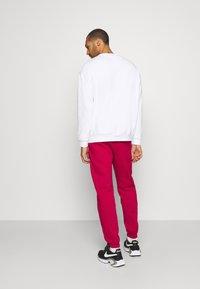 Jordan - PANT - Pantaloni sportivi - red - 2