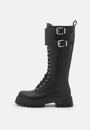 VEGAN HURRICANES - Lace-up boots - black