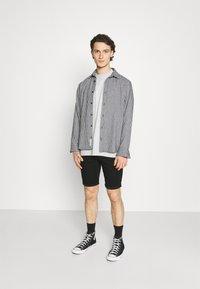 Hollister Co. - CLEAN  - Denim shorts - black - 1