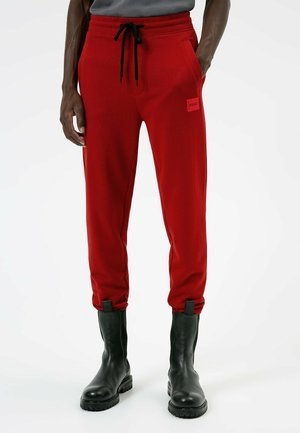 DOAK - Tracksuit bottoms - red