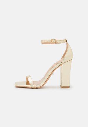 Sandales à talons hauts - gold mirror