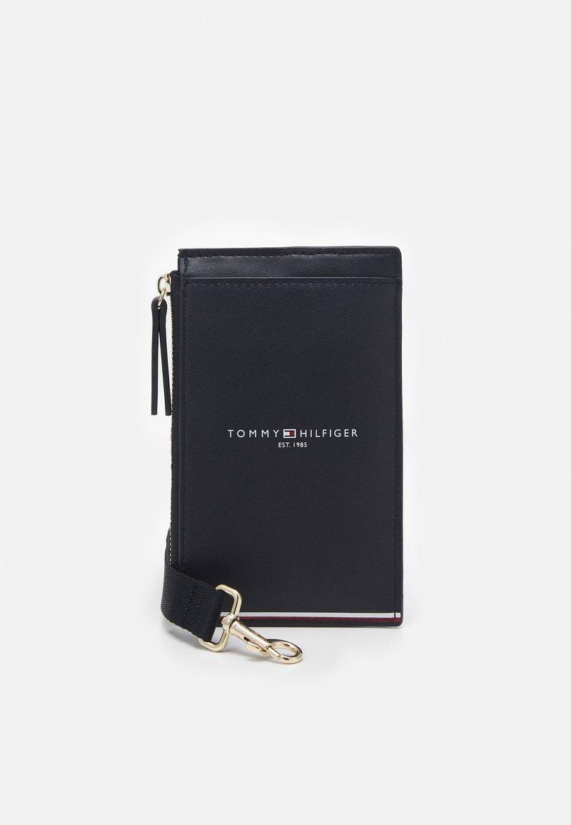 Tommy Hilfiger - PHONE WALLET - Across body bag - blue