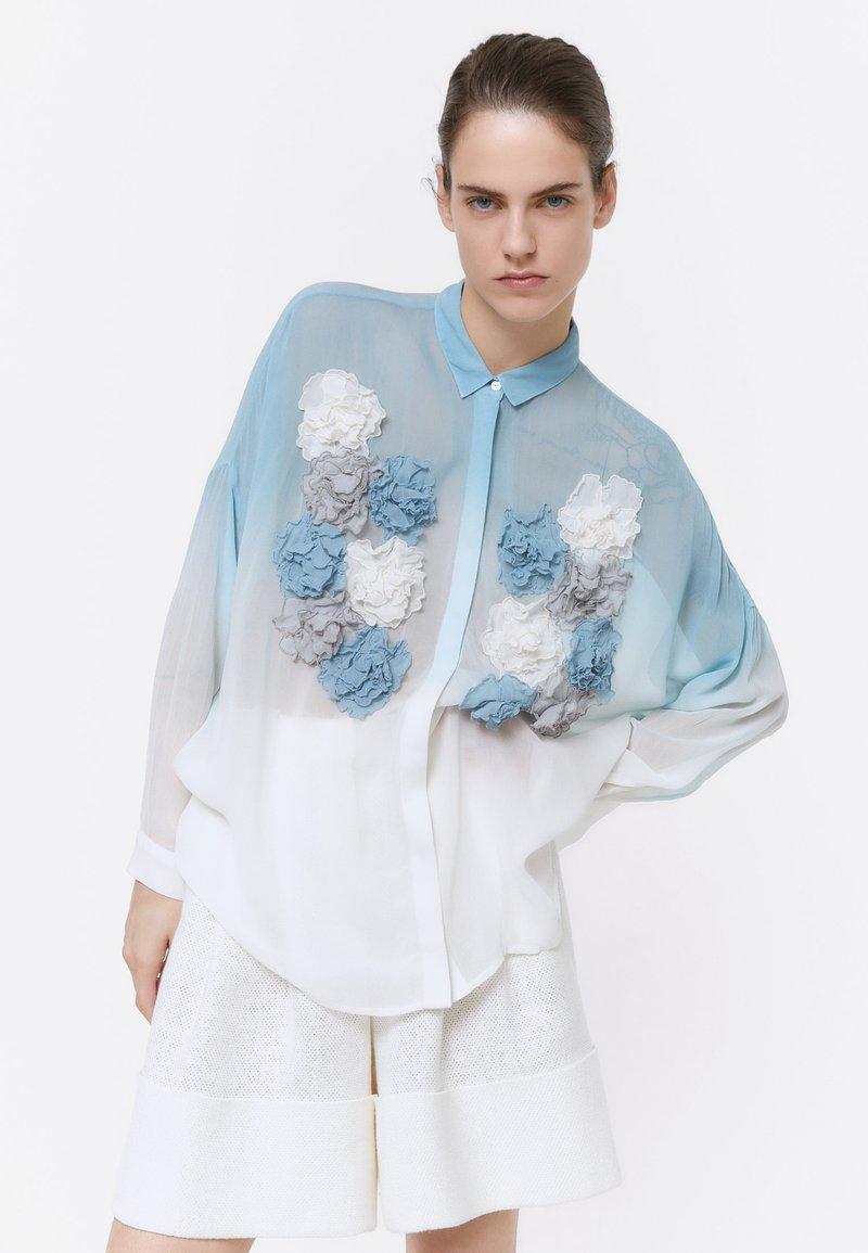 Uterqüe - Button-down blouse - blue