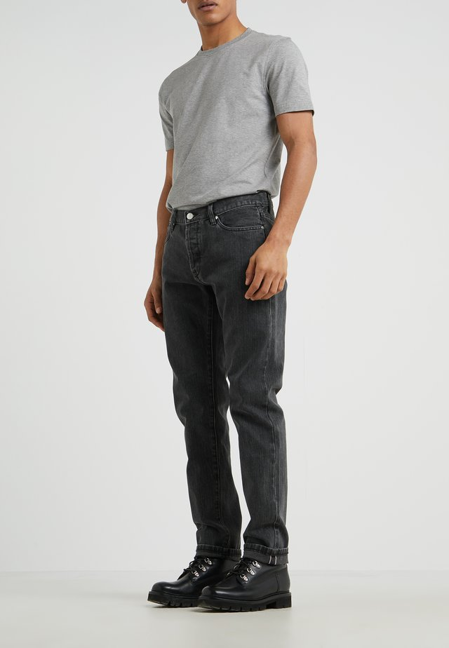 Jeans Tapered Fit - black stone wash