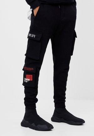 Träningsbyxor - black