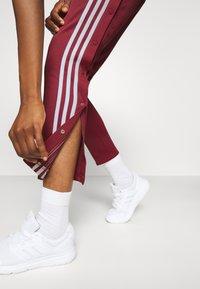 adidas Performance - SNAP PANT - Joggebukse - legred - 4