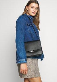 Calvin Klein - RETRO SHOULDER BAG - Torba na ramię - black - 1