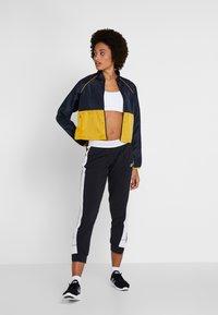 New Balance - VELOCITY JACKET - Sports jacket - varsgold - 1