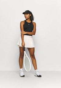 Nike Performance - DRY SKIRT - Sports skirt - guava ice/black - 1