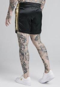 SIKSILK - MUAY TIE - Shorts - black/gold - 4