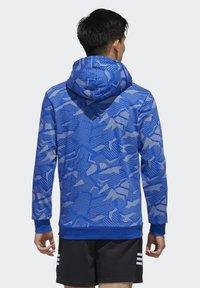 adidas Performance - ESSENTIALS ALLOVER PRINT HOODIE - Hoodie - blue - 1
