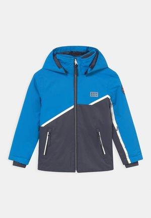 JEBEL UNISEX - Snowboard jacket - blue