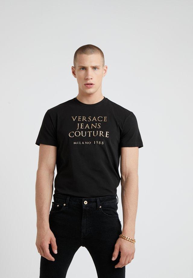 MAGLIETTE UOMO - T-shirt z nadrukiem - nero