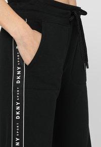 DKNY - TRACK PANT W/SIDE SLIT - Tracksuit bottoms - black - 5