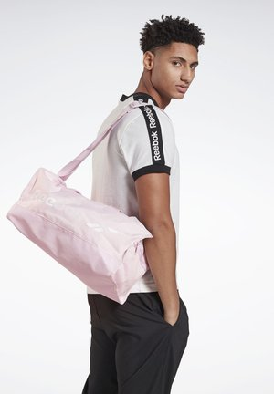 TRAINING ESSENTIALS GRIP BAG SMALL - Sports bag - pink